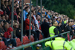 Supporters of Irish club Bohemians watching the action at Park Hall Stadium, Oswestry during their team's Champions League 2nd qualifying round 2nd leg game away to The New Saints. Despite leading 1-0 from the first leg, the Dublin club went out following their 4-0 defeat by the Welsh champions. The match was the first-ever Champions League match in the UK played on an artificial pitch and was staged at the Welsh Premier League's ground which was located over the border in England.
