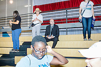 People gather in the bleachers after a campaign rally for Democratic presidential nominee Hillary Clinton in the Theodore R. Gibson Health Center at Miami Dade College-Kendall Campus in Miami, Florida, USA.