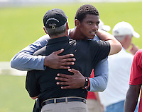 HEMPFIELD TOWNSHIP, PA - AUGUST 20:  Terrelle Pryor hugs former Ohio State University football coach Jim Tressel following his work out during his pro day at a practice facility on August 20, 2011 in Hempfield Township, Pennsylvania.  (Photo by Jared Wickerham/Getty Images)
