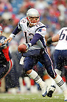 New England Patriots quarterback Tom Brady looks to make a hand-off against the Buffalo Bills at Ralph Wilson Stadium in Orchard Park, NY, on December 11, 2005 . The Patriots defeated the Bills 35-7. Mandatory Photo Credit: Ed Wolfstein