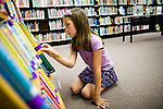 Vivian Ferrell looks for books at a library in Auburn, CA  May 13, 2009.