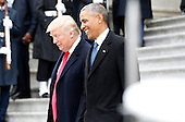 Former President of the United States Barack Obama and  United States President Donald Trump smile as they walk down the east front steps of the Capitol Building after Trump is sworn in at the 58th Presidential Inauguration on Capitol Hill in Washington, D.C. on January 20, 2017.   <br /> Credit: John Angelillo / Pool via CNP