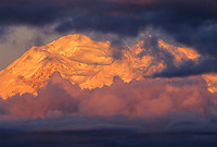 North and South peaks of Denali, (Mt. McKinley) north America's highest mountain, viewed from stony Dome, storm clouds at sunrise, Denali National Park, Alaska