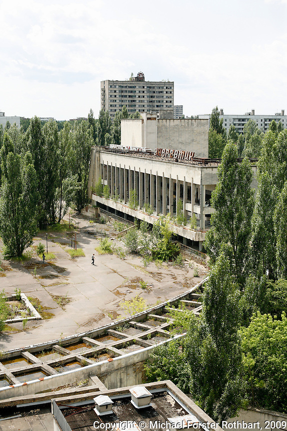 &ldquo;If the accident happened today, I simply would not leave. I&rsquo;d try to stay, to the extent possible, and use my strength to help.&rdquo; &mdash; Sasha Sirota, evacuee and co-founder of Pripyat.com<br /> <br /> The central square of Pripyat is overgrown with trees. The entire city of almost 50,000 was evacuated in a day, while firemen tried fruitlessly to douse the fire in the reactor. Tourists visit here every week on guided excursions, their shouts ringing across the plaza. When former residents visit, they search quietly, struggling to match old memories with the scene before them. Others refuse to return, preferring to recall their hometown as they knew it: a paradise lost.<br /> <br /> Sasha&rsquo;s mother, poet Lyuba Sirota, writes that &ldquo;the town Pripyat&hellip; after the explosion at the station, has simply ceased to exist, and together with it we&mdash;former inhabitants of Pripyat, also have ceased to exist.&rdquo; <br /> ------------------- <br /> This photograph is part the book of Would You Stay?, by Michael Forster Rothbart, published by TED Books in 2013. The photos come from Forster Rothbart&rsquo;s two long-term documentary photography projects, After Chernobyl and After Fukushima.<br /> &copy; Michael Forster Rothbart 2007-2013.<br /> www.afterchernobyl.com<br /> www.mfrphoto.com &bull; 607-267-4893 &bull; 607-436-2856 <br /> 34 Spruce St, Oneonta, NY 13820<br /> 86 Three Mile Pond Rd, Vassalboro, ME 04989<br /> info@mfrphoto.com<br /> Photo by: Michael Forster Rothbart<br /> Date:  7/2009    File#:  Canon 5D digital camera frame 73320<br /> -------------------