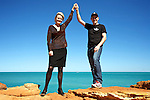"Melissa Parke, MP Federal Member for Fremantle and Jeff Hansen, Australian Director of the Sea Shepherd standing on the rocks at Gantheaume Point in Broome,Western Australia,2012..Far away in the background is the  Vessel  ""Steve Irwin"" making it's way to the port in Broome."