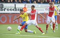 VOETBAL: CAMBUURSTADION: LEEUWARDEN: 15-12-2013, SC Cambuur AJAX, uitslag 1-2,  Ricardo van Rhijn (#2) AJAX in duel met Lucas Bijker (#17), ©foto Martin de Jong