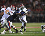 Alabama running back Jalston Fowler (45) is hit by Ole Miss' Mike Marry (52) at Vaught-Hemingway Stadium in Oxford, Miss. on Saturday, October 14, 2011. Alabama won 52-7.