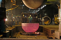 One of two new hemispheres for the research submarine Alvin cools at Wisconsin-based forge, Ladish, in June 2008. Once forged, the hemispheres, which began as 35,000 pounds of titanium ingots, were welded together using an electron beam to form a personnel sphere for the sub. In 2011, the brand-new sphere were installed as part of an upgrade to Alvin that will also include new flotation, a new command and control system, and improved imaging systems. New batteries will allow the submersible to reach depths of 6500 meters, giving scientists up-close and personal access to 98% of the sea floor.