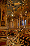 Santa Maria delle Grazie Sanctuary Brescia, Italy is a neo-gothic church dedicated to Santa Maria with intricate marble floors and pillars, stained glass windows, and paintings