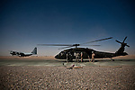 "10/5/2010 FOB Dwyer, Helmand Province, Afghanistan.A US Army Medevac UH-60 Blackhawk Refuels between missions at Forward Operating Base Dwyer in Afghanistan's Helmand Province...The Helicopter Medevac teams of Task Force Destiny, based at Forward Operating Base Dwyer in Afghanistan's war-torn Helmand Province have a tough job. Servicing a large area that includes still restive southern Marjah, and much of the Helmand River Valley, TF Destiny answers the call to transport gravely wounded US Marines and Afghan civilians from the point of injury in the field to Role 3 trauma centers on bases in the area--often times landing under fire to extract Marines and soldiers that would otherwise succumb to their wounds. After the Medevac helicopter and it's ""chase"" UH-60 Blackhawk companion aircraft get a call, they can be on the ground picking up a patient in as little as 20 minutes--delivering the fallen to a surgical theater within what flight medics refer to as ""the golden hour""--or the hour after a catastrophic injury during which a patients transfer from basic battlefield triage care to a modern trauma surgical unit can mean the difference between life and death. ."