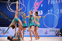 Rhythmic group from Italy performs with 5-hoops at 2010 Pesaro World Cup on August 29, 2010 at Pesaro, Italy.  Photo by Tom Theobald.