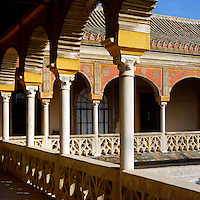Detail of corner of upper portico, Casa de Pilatos (Pilate's House), Seville, Spain, pictured on December 30, 2006, in the afternoon. Pilate's House, late 15th century, was built by the Enriquez and Ribera families During the 16th century these families, who had a strong relationship with Italy,  introduced the Renaissance style to Seville. The buildings were further modified according to Romantic taste in the 19th century and now present a combination of Mudejar-Gothic, Renaissance and Romantic styles. Today the Casa de Pilatos belongs to the Fundacion Casa Ducal de Medicaneli and is the residence of the Dukes of Medicaneli. Picture by Manuel Cohen.