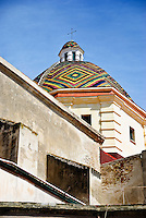 The Colorful tiled dome of San Michele church in Alghero, Sardinia, Italy