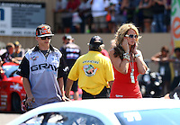 Jul. 21, 2013; Morrison, CO, USA: NHRA crew members and the wife of pro stock driver Shane Gray during the Mile High Nationals at Bandimere Speedway. Mandatory Credit: Mark J. Rebilas-
