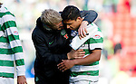 St Johnstone v Celtic..30.10.10  .Emilio Izaguirre gets a hug from Johan Mjallby at full time.Picture by Graeme Hart..Copyright Perthshire Picture Agency.Tel: 01738 623350  Mobile: 07990 594431