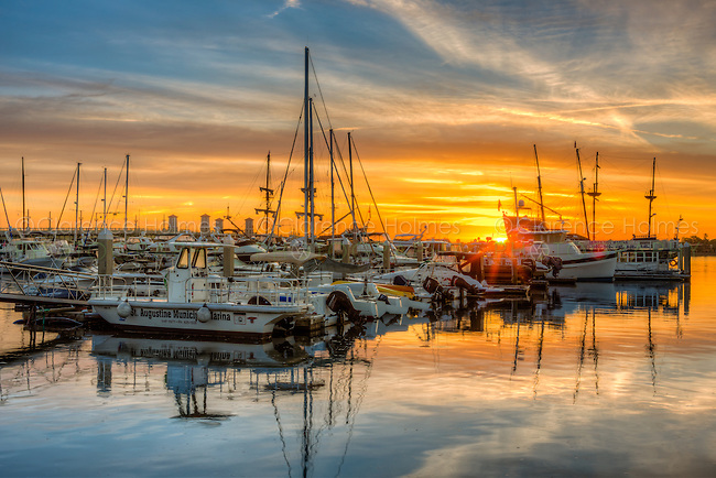 The sun rises over boats docked at the St. Augustine Municipal Marina in St. Augustine, Florida.