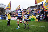 Tom Ellis of Bath Rugby, mascot in hand, runs out onto the field. Aviva Premiership match, between Bath Rugby and Saracens on December 3, 2016 at the Recreation Ground in Bath, England. Photo by: Patrick Khachfe / Onside Images