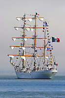 "The Mexican Navy's tall ship Cuauhtémoc sails into the fog on San Francisco Bay during a visit in 2005. Cuauhtémoc, whose name means ""eagle that swoops down over its prey"" was the last emperor of the Aztecs. Built in 1982 at the Celaya Shipyards in Bilboa, Spain, the Cuauhtémoc has a spar length of 270 feet, draft of 17 feet 1 inch, beam of 39 feet 4 inches, and a weight of 1800 tons. Since her first transatlantic journey in 1982 she has sailed over 400,000 miles and in 1990 the vessel made a circumnavigation. Photographed 8/05"
