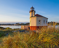 Bandon, Oregon   <br /> Morning sun on the Coquille River Lighthouse and dune grasses