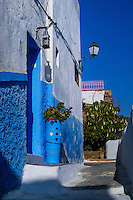 The Kasbah of the Oudayas is located at the mouth of the Bou Regreg river in Rabat, Morocco. Colourful blue and white buildings.