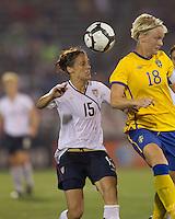 US defender Kate Markgraf (15) and Sweden midfielder Nilla Fischer (18) battle for head ball. The US Women's national team beat Sweden, 3-0, at Rentschler Field on July 17, 2010.