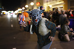 A werewolf runs out of the Kentucky Theatre in downtown Lexington at  the start of the Thriller Zombie parade, Sunday, Oct. 30, 2011. Photo by Brandon Goodwin | Staff.