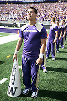 2013-09-21: Washington cheerleader Randy Tran entertained fans during the game  against Idaho State.  Washington won 56-0 over Idaho State in Seattle, WA.