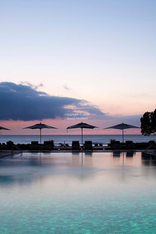 The Four Seasons Resort Hualalai at Historic Kaupulehu on the Big Island of Hawaii. The Beach Tree Pool at sunset.