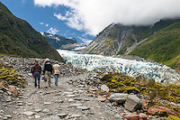 Tourists on track at terminus of Fox Glacier, Westland National Park. West Coast, World Heritage Area, New Zealand
