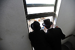 Ultra-Orthodox Jewish men observe as they take part in a burial ceremony in Bnei Brak, central Israel, for Torah scrolls that were destroyed in a fire. Eleven torah scrolls were burnt in a fire that broke out in a synagogue during the Jewish holiday of Sukkot, following a short circuit in the Holy Ark.