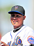2 March 2010: New York Mets' shortstop Ruben Tejada stands outside the dugout prior to a game against the Atlanta Braves during the Opening Day of Grapefruit League play at Tradition Field in Port St. Lucie, Florida. The Mets defeated the Braves 4-2 in Spring Training action. Mandatory Credit: Ed Wolfstein Photo
