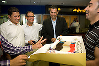 At the studios of news channel Al Jazeera English, a group of local Egyptians bring in a cake as a thank you for the channel's coverage of the protests in their country.