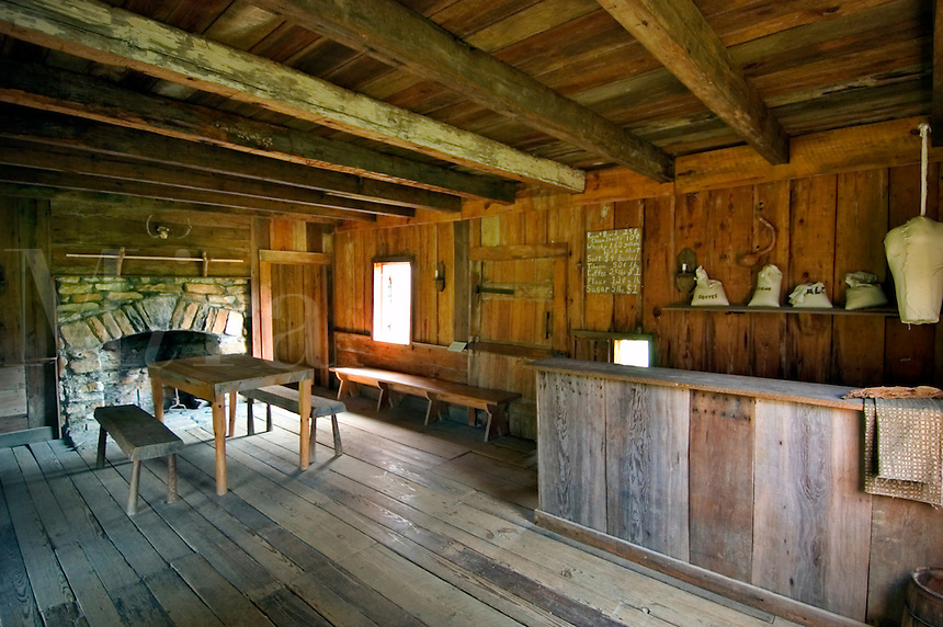 """Interior of the Vann Tavern, a Cherokee store built around 1805 by James Vann, a wealthy Cherokee plantation owner.  Moved to New Echota in 1955, it was originally built near the Chattahoochee River in what is now Forsyth County, Georgia.  The tavern served travelers on the Federal Road as a restaurant, store, and inn.  The small opening behind the counter served as a """"""""take out service window,"""""""" for those not allowed inside (slaves, children, etc.)."""