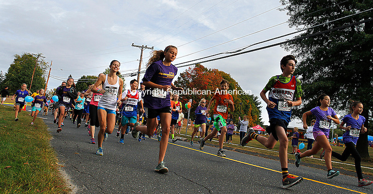 """WOODBURY, CT - 26 SEPTEMBER 2015 - 092615JW14.jpg -- Runners start off on the 5K portion of the 5th Annual Go The Distance For Scholars at Mitchell School in Woodbury Saturday morning. Last year, """"Go the Distance"""" netted over $34,000 with proceeds fully supporting student scholarships. Jonathan Wilcox Republican-American"""