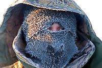 A man shields himself from the extremely cold weather in Tomtor, one of the coldest inhabited places on earth having recorded some of the lowest temperatures.