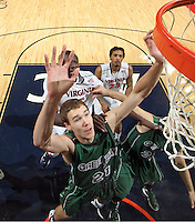 CHARLOTTESVILLE, VA- NOVEMBER 26:  Alec Brown #21 of the Green Bay Phoenix during the game on November 26, 2011 at the John Paul Jones Arena in Charlottesville, Virginia. Virginia defeated Green Bay 68-42. (Photo by Andrew Shurtleff/Getty Images) *** Local Caption *** Alec Brown