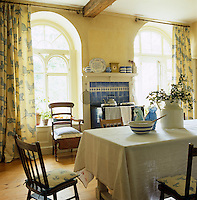 In this country kitchen the long table is the focal point of the room and the Aga, which stands against one wall, becomes a piece of furniture