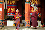 Asia, Bhutan, Thimpu. Women at the prayer wheels of the Memorial Chorten in Thimpu, Bhutan.