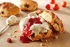 Traditional British scones with clotted cream and apricot jam stock photos