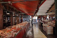 Fish stalls of the Rialto Market on the Grand Canal, Venice, Italy. The market was opened here in the 11th century and sells locally caught lagoon and seafood and other fresh produce. The city of Venice is an archipelago of 117 small islands separated by canals and linked by bridges, in the Venetian Lagoon. The historical centre of Venice is listed as a UNESCO World Heritage Site. Picture by Manuel Cohen
