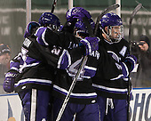 The Crusaders celebrate Stockton's goal. - The Bentley University Falcons defeated the College of the Holy Cross Crusaders 3-2 on Saturday, December 28, 2013, at Fenway Park in Boston, Massachusetts.