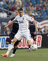 Vancouver Whitecaps FC forward Sebastien Le Toux (7) in the penalty area attempts to control the ball as New England Revolution defender AJ Soares (5) pressurs. In a Major League Soccer (MLS) match, the New England Revolution defeated Vancouver Whitecaps FC, 4-1, at Gillette Stadium on May 12, 2012.