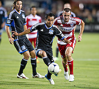 SANTA CLARA, CA - July 18, 2012: San Jose Earthquake midfielder Rafael Baca (30) and FC Dallas midfielder Andrew Jacobson (4) during the San Jose Earthquakes vs  FC Dallas match at the Buck Shaw Stadium in Santa Clara, California. Final score San Jose Earthquakes 2, FC Dallas 1.