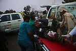 Sirte, LIBYA: Monday 11th October 2011:..A wounded rebel soldier is taken to an ambulance. Military gains came at a heavy price, with medics reporting 13 dead and 90 wounded on the western side of Sirte alone....Ayman Oghanna
