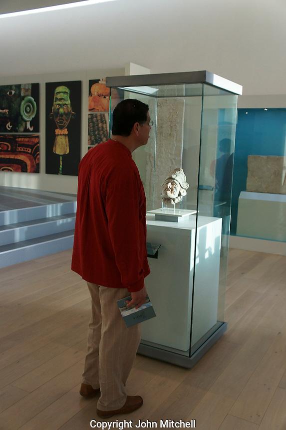 Tourist in the Museo Maya de Cancun or Cancun Mayan Mayan Museum that opened in November 2012, Cancun, Mexico      .