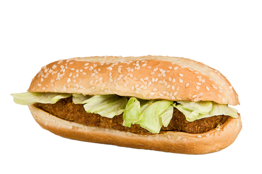 Close up of a Chicken Sandwich, white isolated. Use of selective focus.