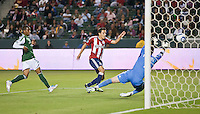 CARSON, CA – June 3, 2011: Chivas USA forward Marcos Mondaini (23) scores the only goal of the game during the match between Chivas USA and Portland Timbers at the Home Depot Center in Carson, California. Final score Chivas USA 1, Portland Timbers 0.