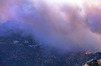 870000404 the topanga wild fire burns along a ridgeline near hillside homes in chatsworth in la county california