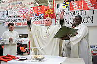 Switzerland. Canton Ticino. Bellinzona. Bishop Piergiacomo Grampa celebrates the mass on Easter sunday at Officine FFS. Catholic religious service. Stabilimento Industriale SBB CFF FFS Cargo. Railway workers on strike. Building's occupation. Protest signs. © 2008 Didier Ruef
