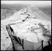 A former Jordanian trench bisects a spur in the Judean desert, 1996. The Trench was overrun in the 1967 war that saw Israel occupy vast reaches of the West Bank of the Jordan River.  .Part of SCARS series. Photo Greg Marinovich / South